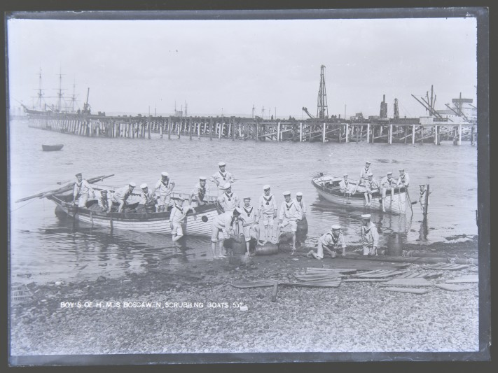 The boys of HMS Boscawen scrubbing boats, 19th century.
